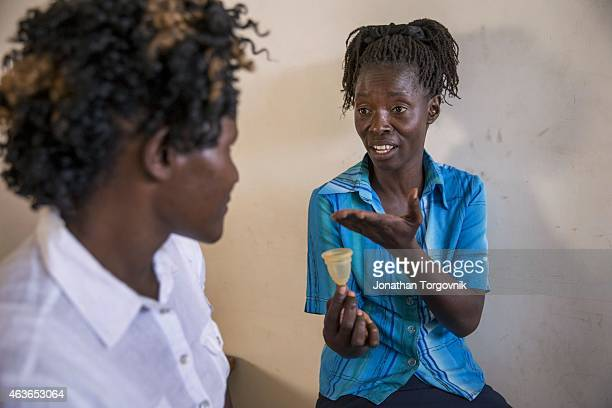 Community health workers supported by APHRC displaying a menstrual cup used by women in Korogocho slum one of Nairobi's most populated informal...