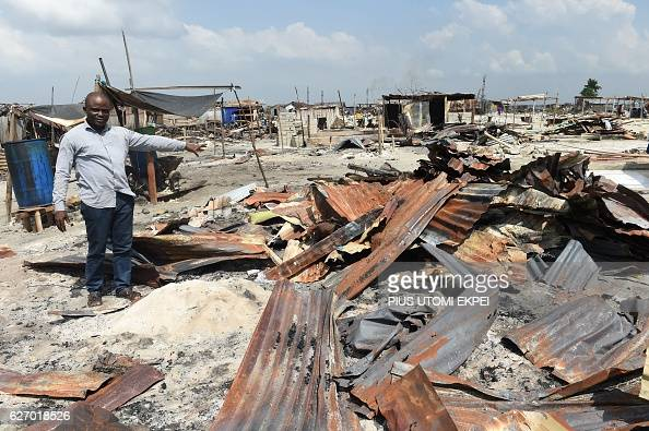 Community leader Celestine Ahisu points to family makeshift home demolished by the authorities at Otodo Gbame waterfront fishing communities in Lagos...