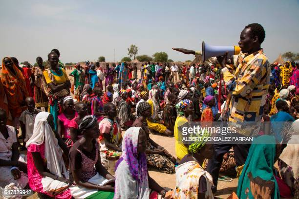 A community leader organises the lines of beneficiaries of a food distribution on March 4 in Ganyiel Panyijiar county in South Sudan South Sudan was...