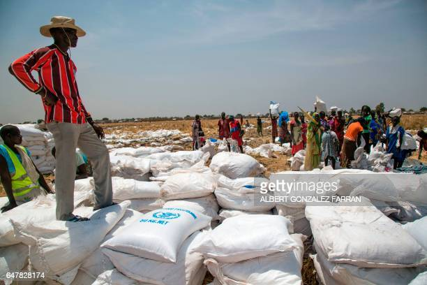 A community leader supervises a food distribution fon March 4 in Ganyiel Panyijiar county Unity state in South Sudan South Sudan was declared the...
