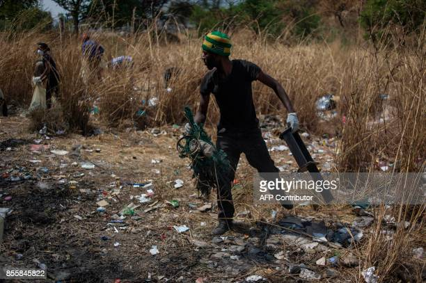 Community leaders and various stakeholders take part in the first monthly volunteer clean up at Emma Park Linden in Johannesburg on September 30 2017...