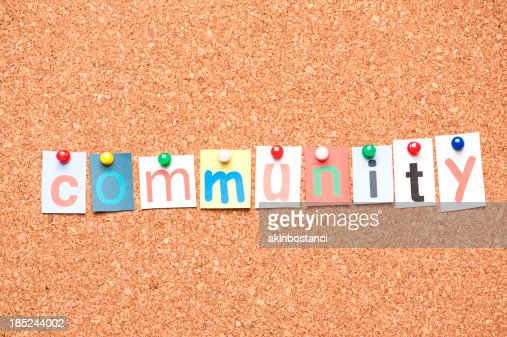 community letters on corkboard stock photo
