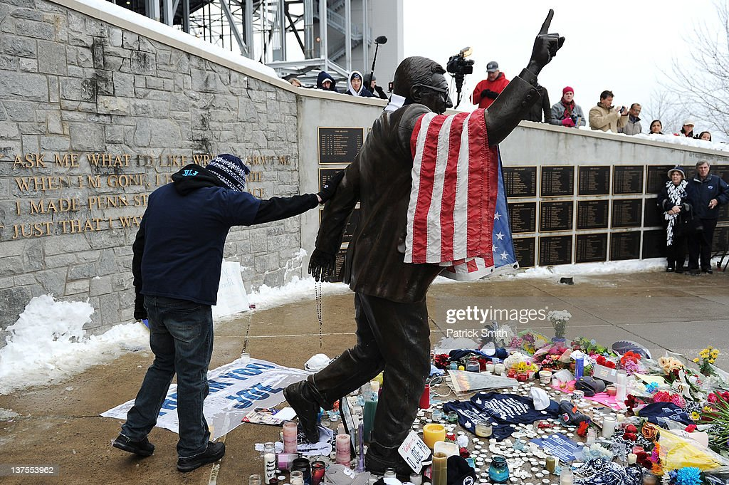 A community member pays his respect at the statue of Joe Paterno, the former Penn State football coach, after hearing of Paterno's death outside of Beaver Stadium on January 22, 2012 in State College, Pennsylvania. Paterno, who was 85 years old, died due to complications from lung cancer.