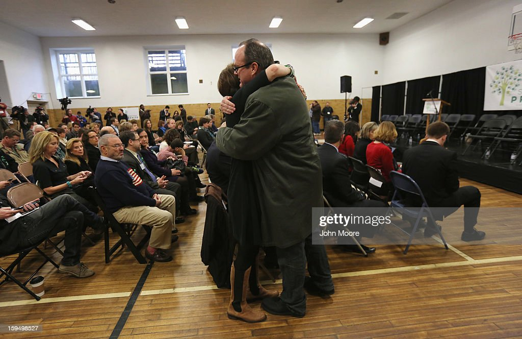 Community members embrace at a press conference with parents of Sandy Hook Elementary victims on the one month anniversary of the Newtown elementary school massacre on January 14, 2013 in Newtown, Connecticut. Eleven families of Sandy Hook massacre victims came to the event one month after the shooting to give their support to Sandy Hook Promise, a new non-profit with the goal of preventing such tragedies in the future.