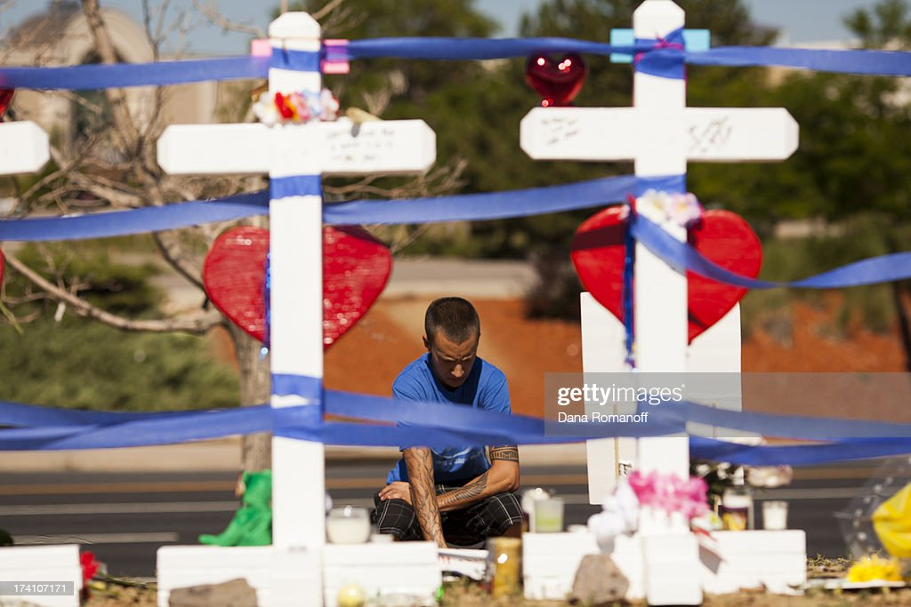 Community members erect twelve crosses at a remembrance ceremony July 20, 2013 in Aurora, Colorado. The ceremony marks the one one-year anniversary of the Aurora Movie Theatre Shootings in which James Holmes killed 12 people and injured more than 50 during a mass shooting in 2012.