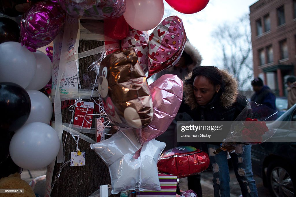 Community members gather during a vigil for slain infant Jonylah Watkins on March 12, 2013 in Chicago, Illinois. The 6-month-old girl was shot five times on the 6500 block of South Maryland Avenue while her father was changing her diaper in the passenger seat of his car. The father, Jonathan Watkins remains is stable condition at Nothwestern Memorial Hospital after receiving three gunshot wounds.