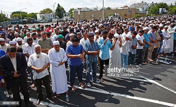 Community members gather during funeral prayers for Imam Maulama Akonjee and friend Thara Uddin at Grant Avenue Municipal Parking Field August 15...