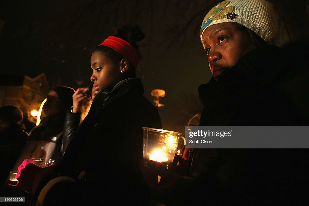 Community members hold a candle light vigil at Harsh park to honor Hadiya Pendleton on February 1, 2013 in Chicago, Illinois. Pendleton, a fifteen-year-old high school honor student, was shot and killed while hanging out with friends on a rainy afternoon under a shelter in the park on January 29. A $40,000 reward has been raised to help find her killer. Pendleton was the 44th homicide recorded in Chicago for 2013.