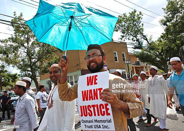 Community members march in the street after funeral prayers for Imam Maulama Akonjee and friend Thara Uddin August 15 2016 in New York New York...