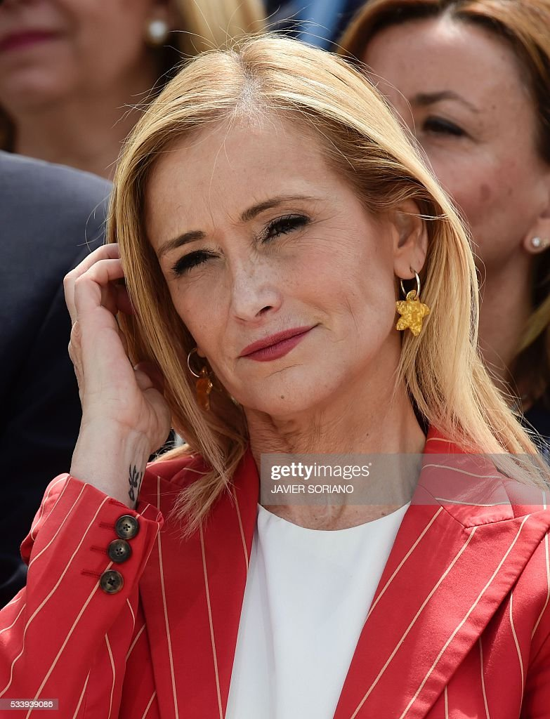 Community of Madrid President Cristina Cifuentes touches her hair during the presentation of the Popular Party (PP) candidates to the Spanish Congress for the June 26 upcoming general election, in Madrid on May 24, 2016. / AFP / JAVIER