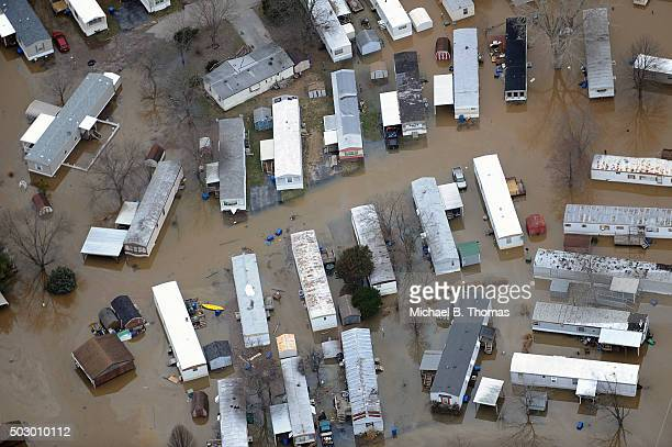 A community of trailer homes are submerged in floodwater from the cresting Meremac River on December 31 2015 in Arnold Missouri The St Louis area and...