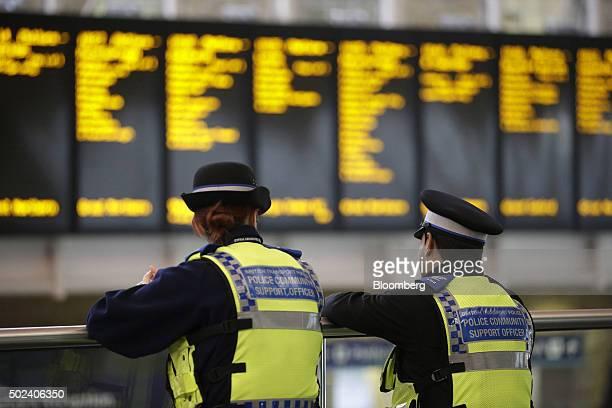 Community Support police officers stand guard in the departure hall at Kings Cross railway station in London UK on Thursday Dec 24 2015 UK stocks...