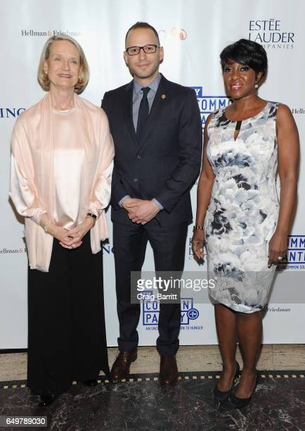 Community Volunteer Candace K Frawley Associate Counsel to Governor Andrew M Cuomo Jonathan Estreich and Cheryl Wills of NY1 News attend the NY...