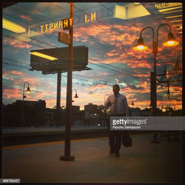 Commuter at sunset at New Jersey transit station