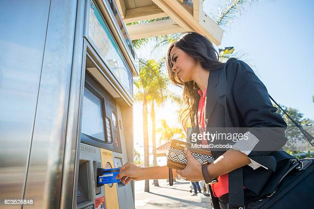 Commuter Buying Her Train Ticket