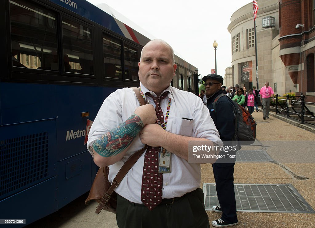 Commuter Corey Pickelsimer of Woodbridge Virginia waits outside the Auditors Building near the intersection of 14th Street and Independence Avenue SW...