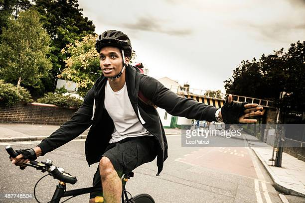 Commuter cycling in Hackney London going at work