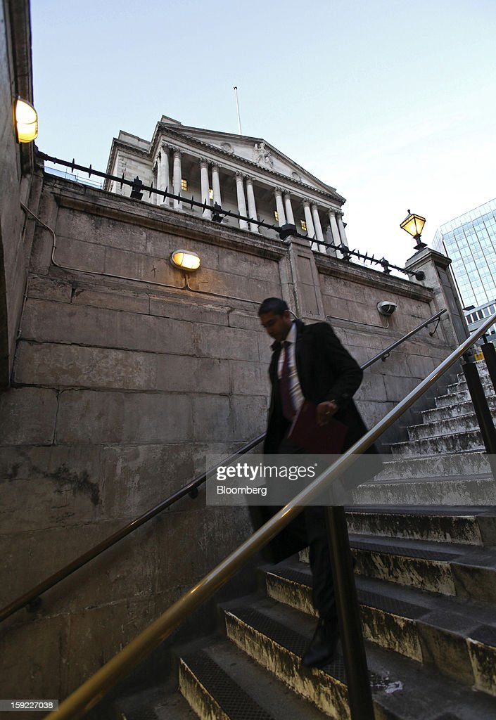 A commuter descends stairs as he enters Bank underground station near the Bank of England (BOE), center, in London, U.K., on Wednesday, Jan. 9, 2013. Bank of England policy makers will probably refrain from adding further stimulus to the U.K. economy today as their new credit-boosting program shows early signs of success. Photographer: Chris Ratcliffe/Bloomberg via Getty Images