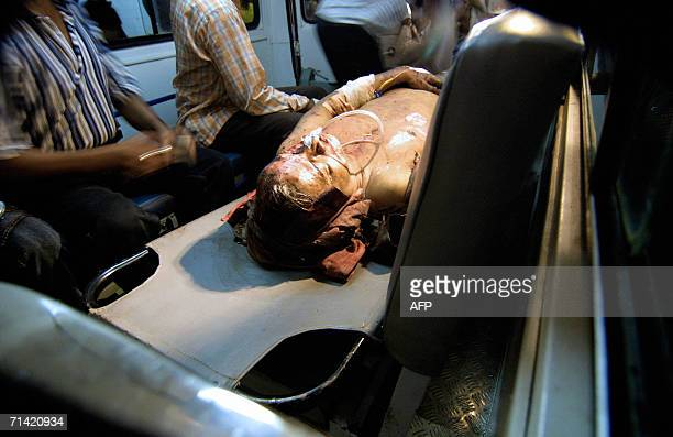 A commuter injured in the local train bomb blast at Jogeshwari station receives first aid in an ambulance in Mumbai 12 July 2006 The death toll from...
