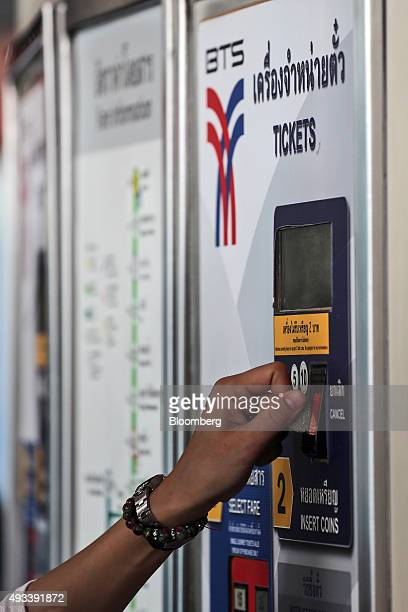 A commuter inserts a coin to buy a tickets ticket for the sky train operated by Bangkok Mass Transit System Pcl SkyTrain a unit of BTS Group Holdings...