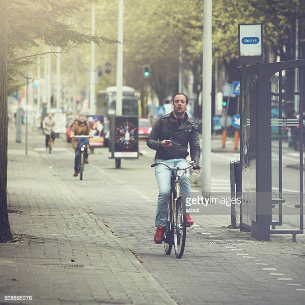 Commuter is riding a bicycle in Amsterdam