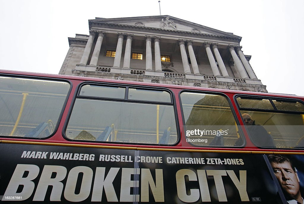 A commuter looks from a window of a London bus as it passes the Bank of England (BoE) in London, U.K., on Thursday, March 7, 2013. The pound dropped to its weakest level in more than 2 1/2 years versus the dollar before Bank of England policy makers announce their decision on whether they will add more stimulus to boost the U.K. economy. Photographer: Simon Dawson/Bloomberg via Getty Images