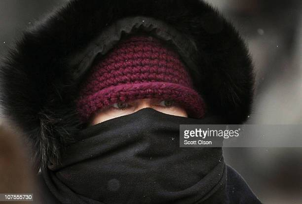A commuter makes her way through downtown as temperatures hovered in the single digits during the morning rush hour December 13 2010 in Chicago...