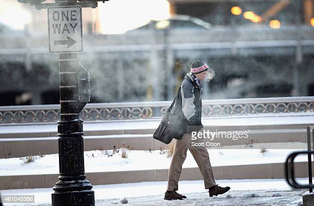 A commuter makes his way to work as temperatures hovered around zero degrees Fahrenheit during the morning rush on January 5 2015 in Chicago Illinois...