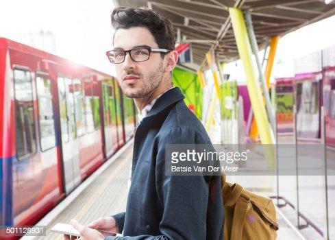 commuter on platform waiting for public transport