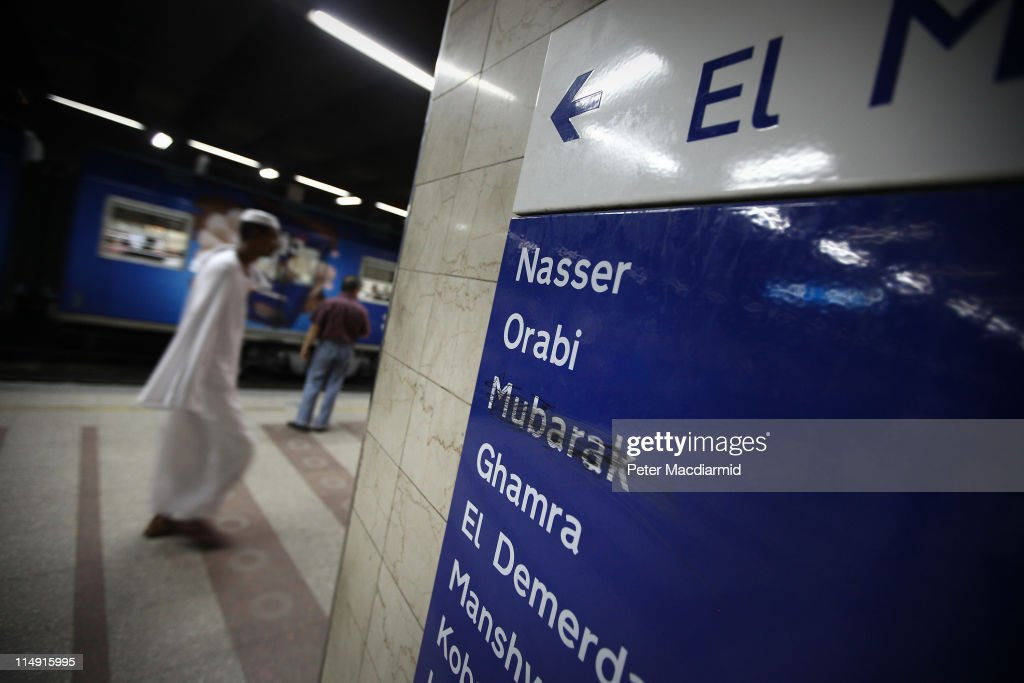 A commuter passes a sign at Sadat Metro Station which shows the defacing of the former Mubarak Station on May 28, 2011 in Cairo, Egypt. Protests in January and February brought an end to 30 years of autocratic rule by President Hosni Mubarak who will now face trial. Food prices have doubled and youth unemployment stands at 30%. Tourism is yet to return to pre-uprising levels.