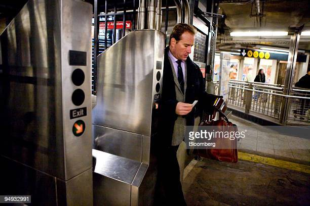 A commuter passes through a turnstile as he enters the 42nd Street subway station in New York US on Thursday Nov 20 2008 The Metropolitan...