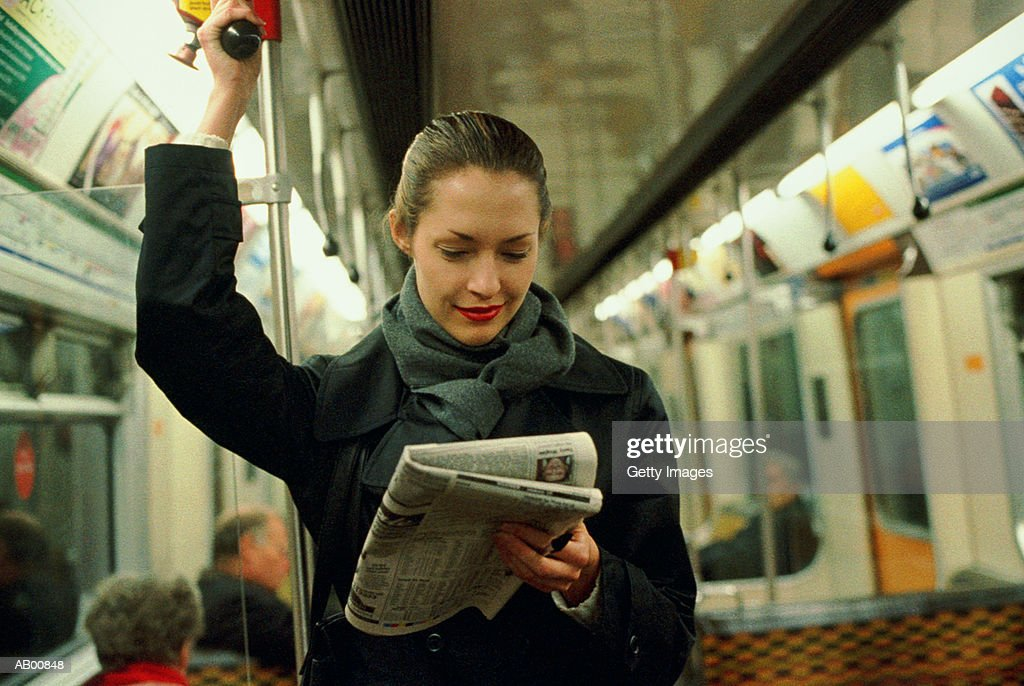 Commuter Reading a Newspaper : Stock Photo