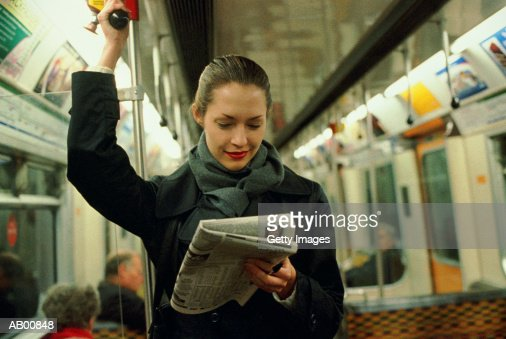 Commuter Reading a Newspaper