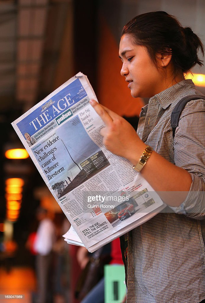 A commuter reads The Age's first compact edition newspaper at Flinders Street Station on March 4, 2013 in Melbourne, Australia. The Sydney Morning Herald and The Melbourne Age published thier first tabloid size editions today, after 180 years of producing weekday broadsheets.