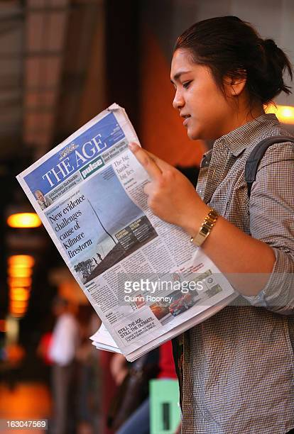 A commuter reads The Age's first compact edition newspaper at Flinders Street Station on March 4 2013 in Melbourne Australia The Sydney Morning...