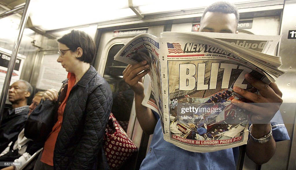 A commuter reads the New York Post with an article about the London terror attacks while riding the subway during the morning rush hour July 8, 2005 in New York City. Security on subway trains and buses was increased in the wake of explosions that killed at least 50 people and injured many others on London's mass transit system July 7, 2005.