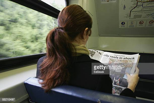 A commuter reads the news on a State Rail Train regarding yesterdays terrorist attack in London July 8 2005 in Sydney Australia At least 38 people...