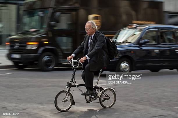 A commuter rides a bike through the traffic in the City during a tube strike in London on July 9 2015 London's roads buses and overland trains...