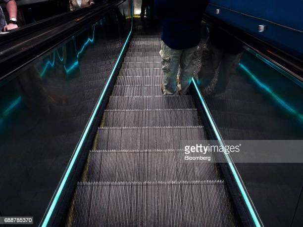 A commuter rides down an escalator inside Pennsylvania Station in New York US on Friday May 26 2017 President Donald Trump tapped New York...