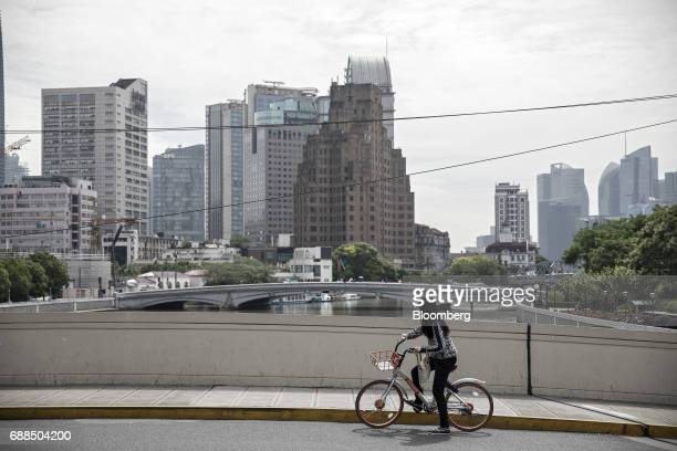 A commuter rides on a Mobike bicycle along a street in Shanghai China on Thursday May 25 2017 In China a bicyclesharing phenomenon is changing the...