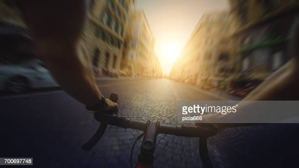 POV commuter riding a road racing bicycle in Rome