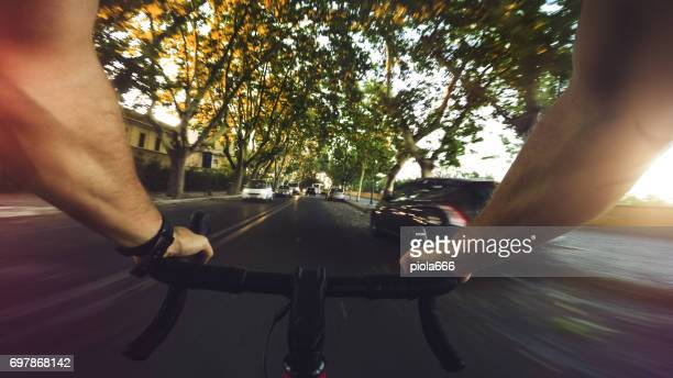 POV commuter riding a road racing bicycle in the city