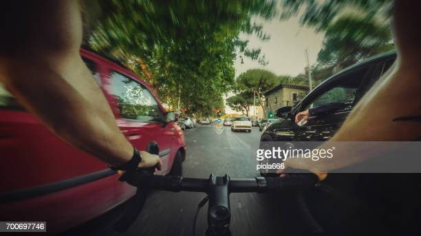 POV commuter riding a road racing bicycle in the traffic