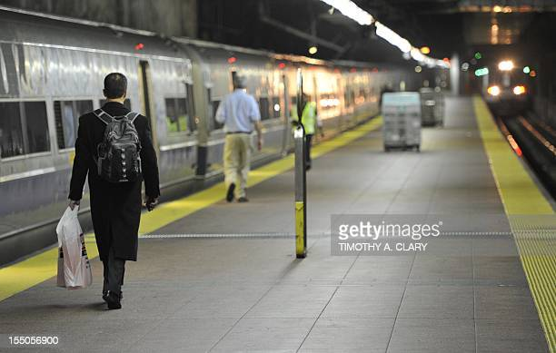 A commuter runs for the first Metro North train at Grand Central Station in New York after the MTA opened up the railroad on a limited schedule...