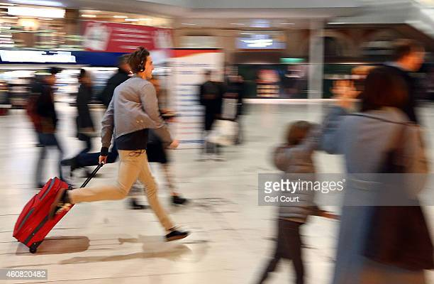 A commuter rushes to a train on December 24 2014 at Waterloo Station in London England Although London buses run 24 hours a day throughout the...