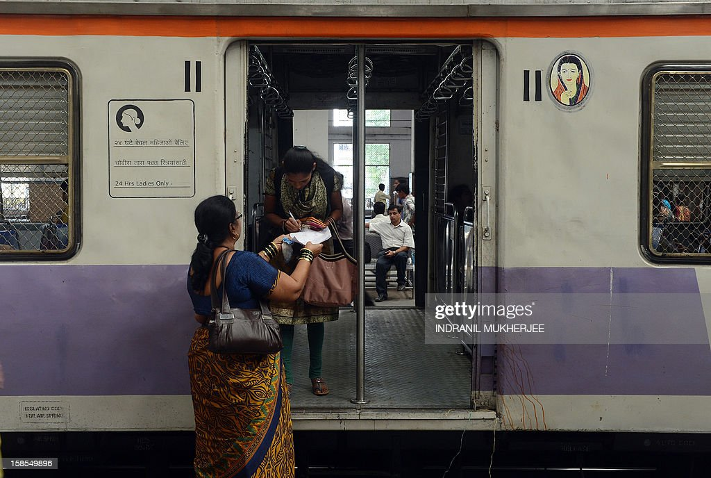 A commuter signs a petition condemning the gang-rape of a 23-old student in New Delhi, at a suburban railway station in Mumbai on December 19, 2012. Indian riot police fired water cannon December 19 during a demonstration in New Delhi held to protest the gang-rape of a 23-year-old student on a bus, witnesses said. Nationwide protests have been held over the incident that has sparked fresh concern for the safety of women in the Indian capital.