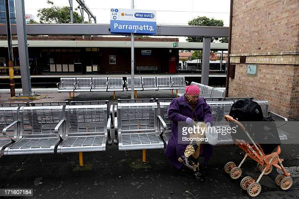 A commuter sits on a bench while waiting for a train at Parramatta station in western Sydney Australia on Monday June 24 2013 Chris Bowen a key...