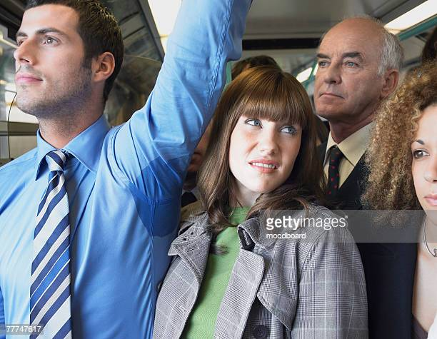 Commuter Standing by Mans Wet Armpit on Train