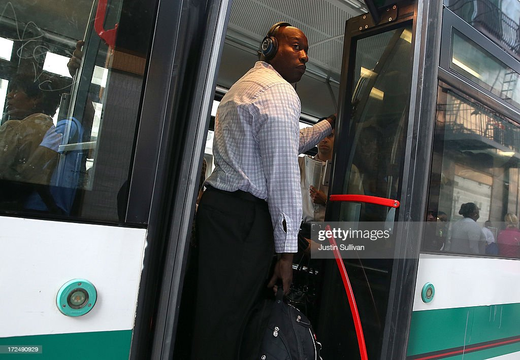A commuter stands inside an Alameda-Contra Costa (AC) Transit bus on July 2, 2013 in Oakland, California. For a second day, hundreds of thousands of San Francisco Bay Area commuters are scrambling to find ways to work after two of San Francisco Bay Area Rapid Transit's (BART) largest unions went on strike early yesterday morning following contract negotiations with management falling apart the day before. Train operators, mechanics, station agents and maintenance workers are seeking a five percent wage increase and are fighting management who want to have workers to begin contributing to their pensions, pay more for health insurance and reduce overtime expenses.