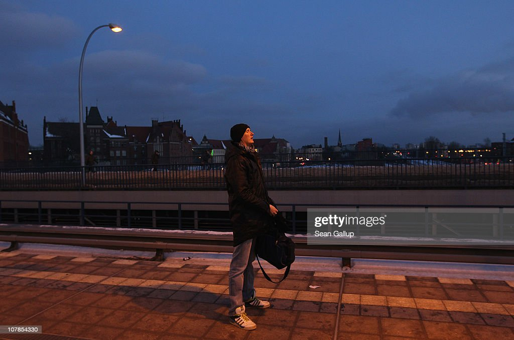 A commuter stands on a train platform of the Berlin S-Bahn commuter rail network at Ostkreuz station on January 3, 2011 in Berlin, Germany. According to media reports out of the S-Bahn's 1,100 train cars only 426 are in service. The others, according to S-Bahn officials, are in repair due to damage caused by the early and harsh winter weather this year. The shortfall in operating trains has led to longer waits for commuters and, in some cases, cancelled service to outlying districts altogether. The Berlin S-Bahn, a subsidiary of the German state rail carrier Deutsche Bahn, has been unable to keep its full fleet of trains operational for the last two years, and critics charge the shortfalls are due to inadequate investment in facilities and personnel.